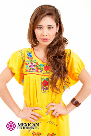 A Traditional Mexican Peasant Dress Hanging Outside Of A Clothing