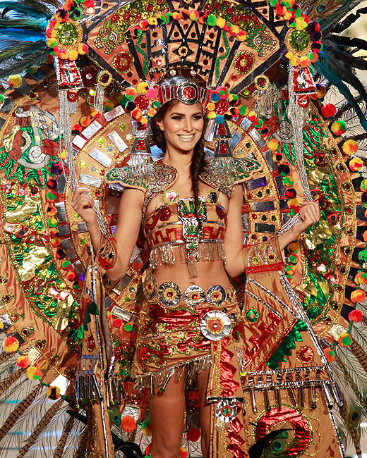 Sophisticated Aztec dress outfit gold feathers and symbols