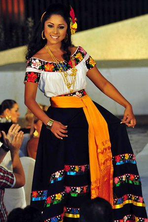 Tabasco elegant Mexican dress with embroidered stripes of flowers and rebozo at the waist